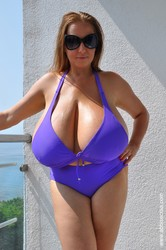 Abbi Secraa - Purple bikini on terrace  27 jpgs
